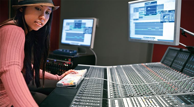 An audio student working hard in the studio