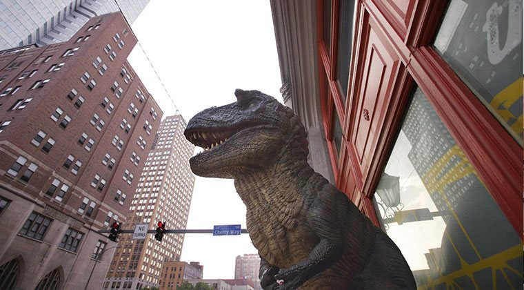"Meet ""Creation Rex,"" a T-Rex dinosaur who also happens to be our iconic mascot. He's located street level, as you enter our building."