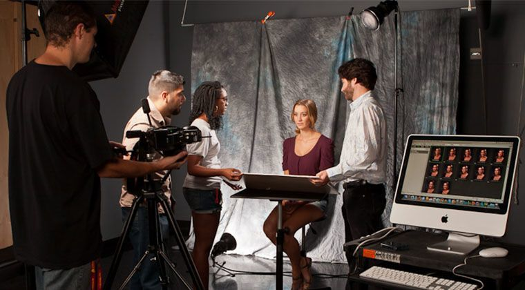 Students set up a photo shoot in one of our dedicated photo studios.