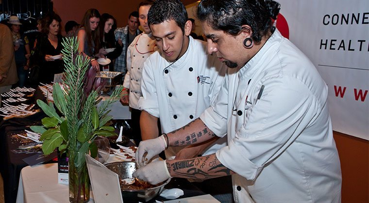Culinary Students served guests to benefit the SIMS Foundation, at the SXSW Austin Music Awards in 2012.
