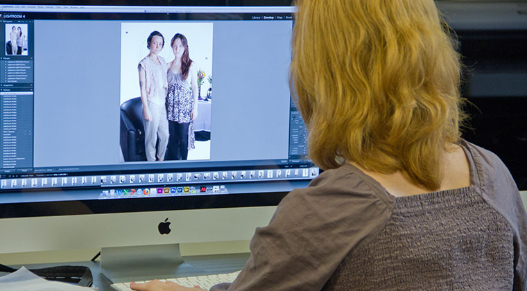 A digital photography student is working on a class project at the Loop campus.