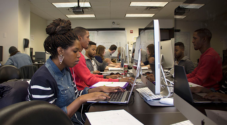 Graphic design students work on projects at the Loop campus.