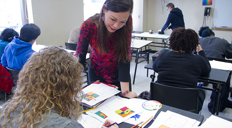 Students in a color theory class get feedback from a professional instructor.
