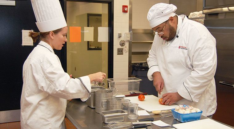 Inside of our professional kitchens, Chef Instructors teach students culinary techniques.