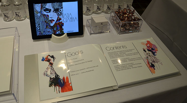 A Fashion Merchandising student's portfolio on display at Miami International University of Art & Design's fall Portfolio Review.