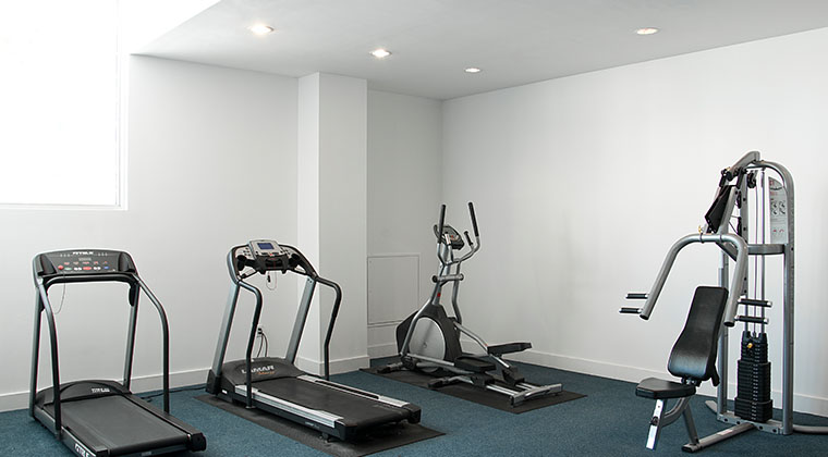 Student housing's 4th floor gym is open to students 24/7 and includes basic gym equipment.