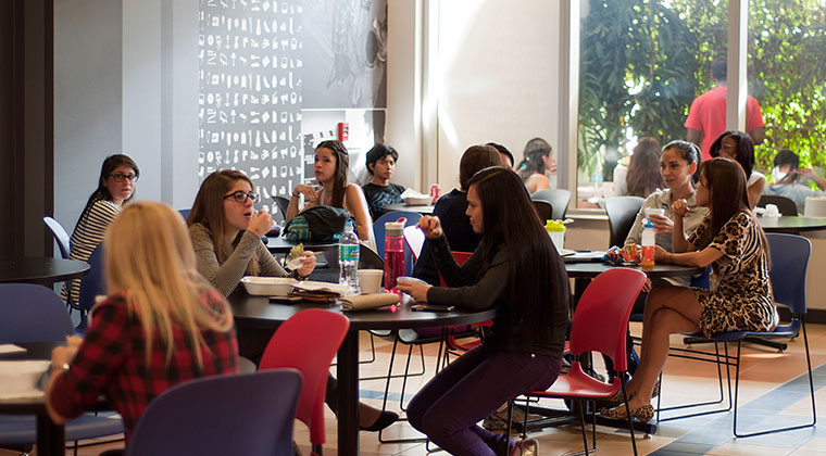 Students enjoy dining in the school's Café.