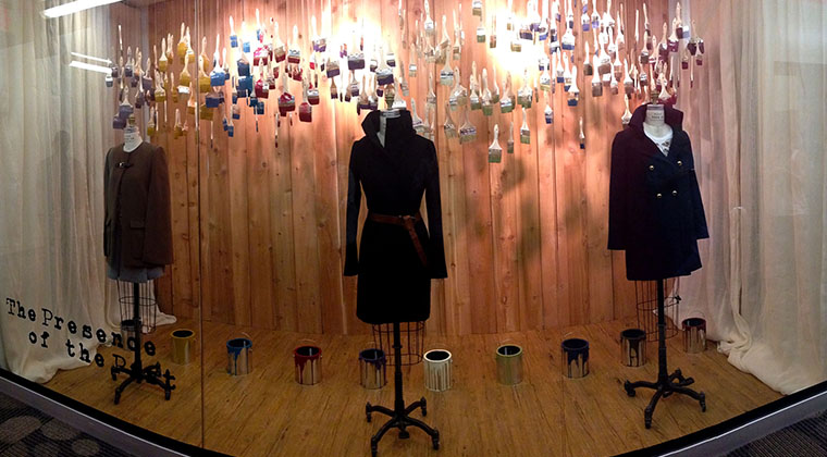 A Fashion Merchandising student installed the Migration Window for the Visual Merchandising III class.