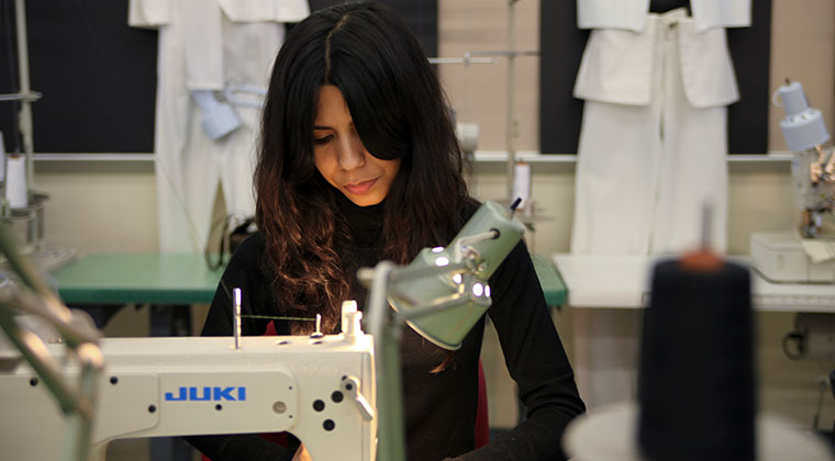 A Fashion Design student in the Patternmaking and Construction III class.