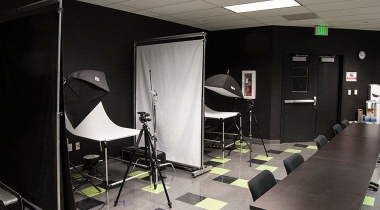 The Lighting Studio provides two lighting systems, backdrops, and a lighting table to assist in students in their coursework.