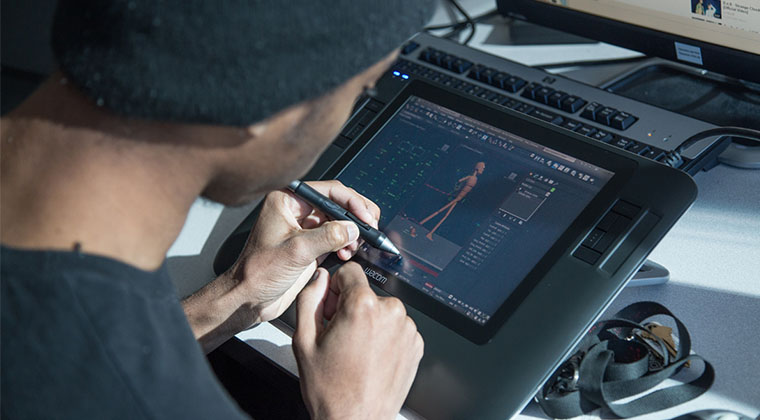 A Media Arts student works with a Cintiq digital drawing tablet.