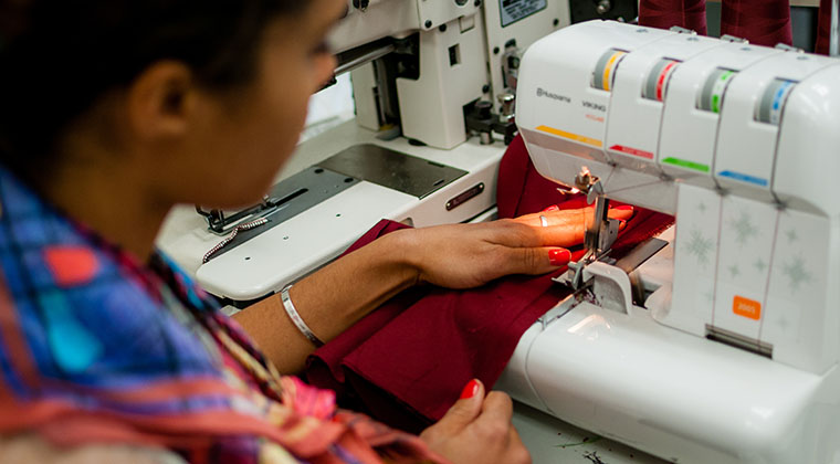 Fashion design students work in our lab that contains industry relevant machines and equipment
